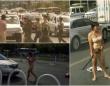 渋滞の先にいた女性。手には金属棒を持っている