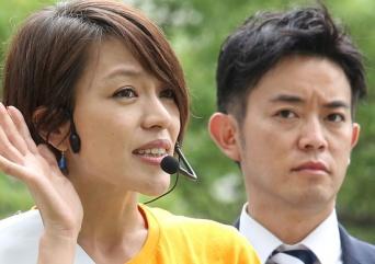 橋本健元神戸市議(右、写真:アフロ)