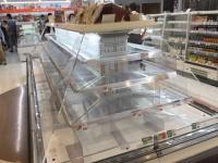 食品が消えたスーパーの棚(写真:アフロ)