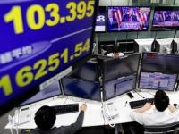 トランプ大統領誕生で、一時大幅安となった東京市場(ロイター/アフロ)
