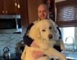 巨大なグレートピレニーズ犬の子犬を抱く飼い主の写真に関する海外の反応