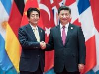 G20での安倍晋三首相(左)と習近平国家主席(右)(写真:picture alliance/アフロ)