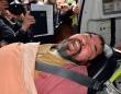 逮捕され、救急車で搬送されるキム容疑者