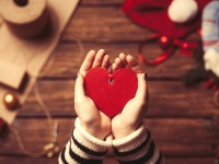 Woman holding a heart shape toy