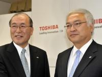 故・西田厚聰氏(左)と佐々木則夫氏(写真:AFP/アフロ