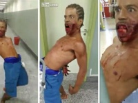 体を後ろに反らし、口から血を流しながら病院の廊下を動き回る男。
